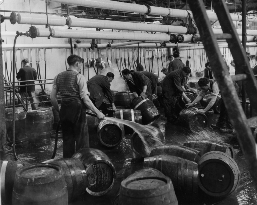 22nd August 1953: Workers at the Guinness brewery at Saint Jame's Gate, Dublin, hosing down barrels Original Publication: Picture Post - 6666 - Ireland's National Drink - pub. 1953 (Photo by Bert Hardy/Picture Post/Getty Images)
